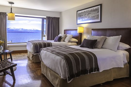 Family Plan with Lake View Fully refurbished rooms that bring out Patagonian tradition and warmth. 27m2 of the utmost comfort with an exclusive view of the Nahuel Huapi Lake.